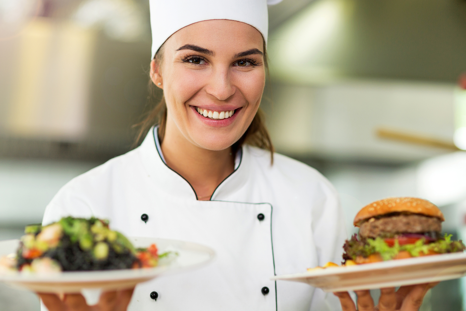 Female Chef With Plates Of Food
