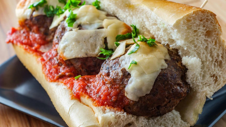 Italian Meatball Parmesan Hero Sandwich On A Torpedo Roll With P