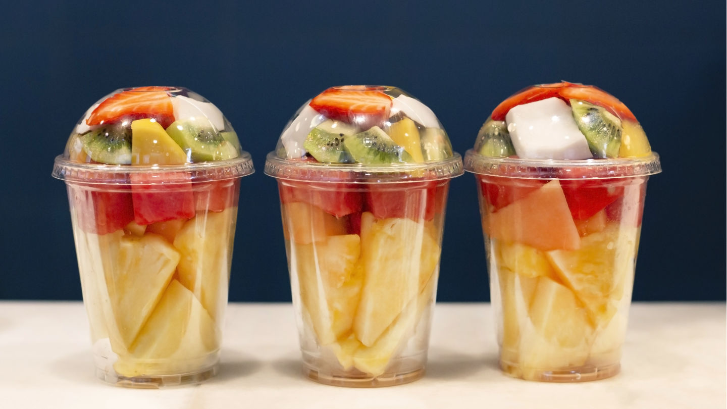 Three Mixed Fruit Vitamin Salad In The Plastic Glass Ready To Ta